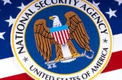 The NSA logo over a US flag
