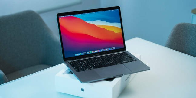 An Apple M1 MacBook on its box on a table