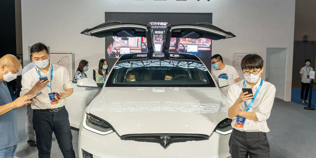 Tesla model X displayed in China auto expo during covid19 pandemic. Staff wear mask