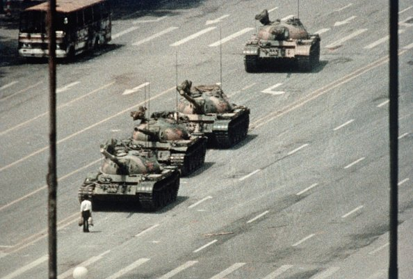 A Beijing demonstrator blocks the path of a tank convoy along the Avenue of Eternal Peace near Tiananmen Square