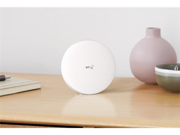 A BT Mini Whole Home Wi-Fi Disc range extender