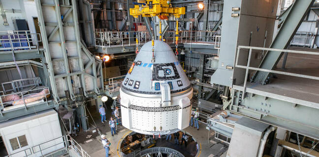 The Boeing CST-100 Starliner spacecraft is guided into position above a United Launch Alliance Atlas V rocket at the Vertical Integration Facility at Space Launch Complex 41 at Florida's Cape Canaveral Air Force Station on Nov. 21, 2019. Credit: NASA/Cory Huston