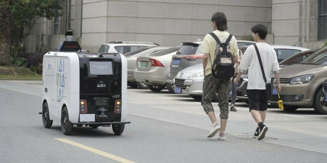 An Alibaba parcel delivery robot in action delivering packages on a university campus in Wuhan, China.