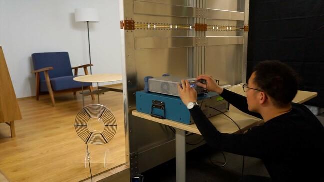 Room-scale magnetoquasistatic wireless power transfer using a cavity-based multimode resonator