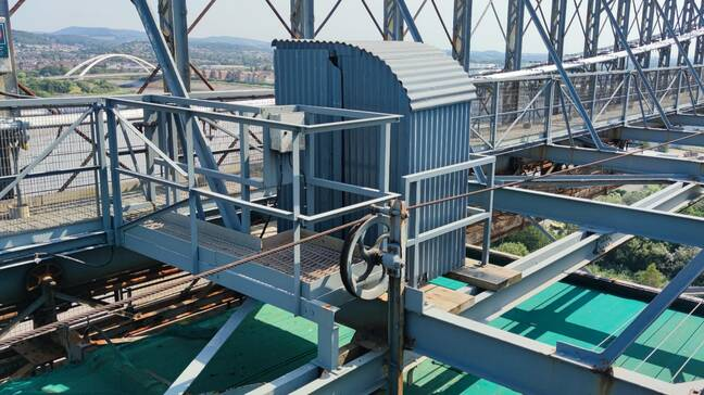 The toilet half way across the truss