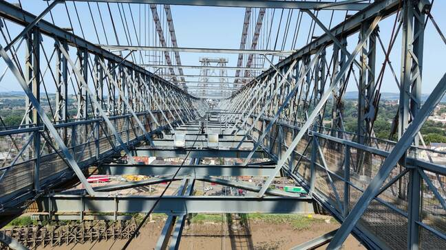 View across the high level truss along which the traveller moves. Foot traffic used the walkways on either side